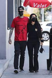 Kourtney Kardashian sees Travis Barker's Blood in a Vial in an edgy photo.